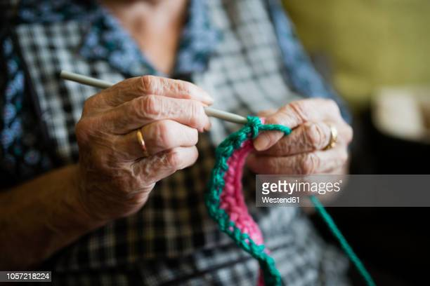 hands of senior woman crocheting, close-up - crochet stock pictures, royalty-free photos & images