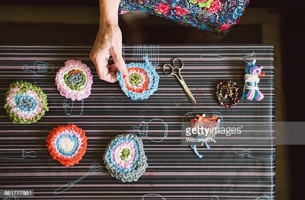 Hands of senior woman holding crochet