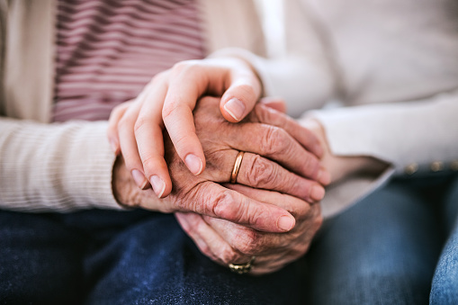 Hands of teenage girl and her grandmother at home. 924108718