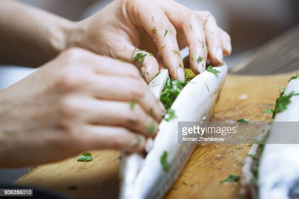 hands of woman chef preparing fish food - food state stock pictures, royalty-free photos & images