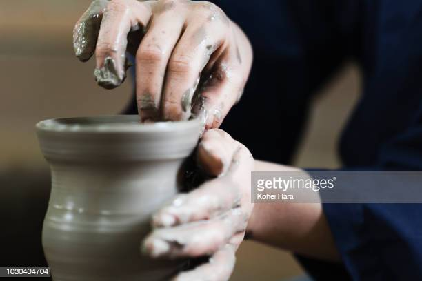 hands of woman enjoying pottery - ceramic stock photos and pictures