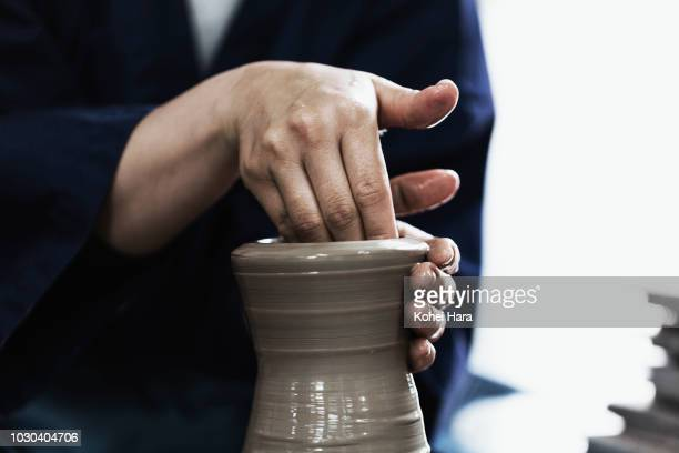 Hands of woman enjoying pottery