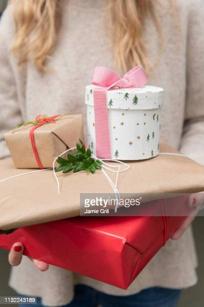 hands of woman holding christmas presents - montclair stock pictures, royalty-free photos & images