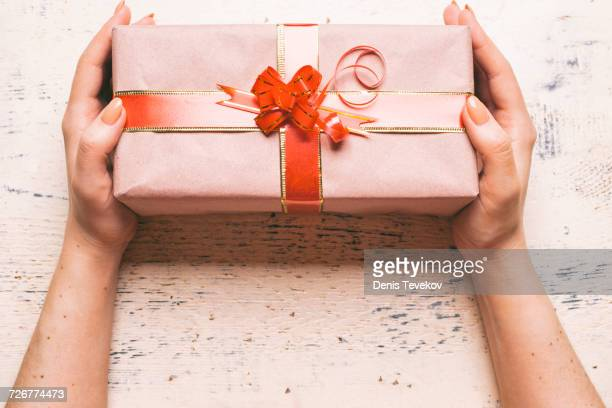 Hands of woman holding gift box