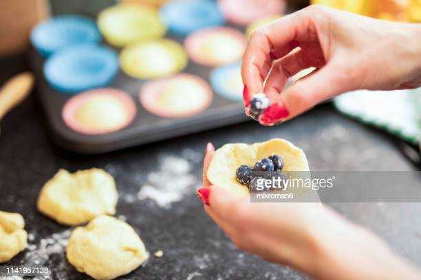 hands of woman kneading a dough at the kitchen. heart shape - red nail polish stock pictures, royalty-free photos & images