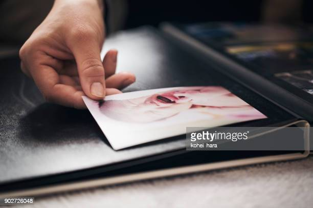 hands of woman  making a photo album - childhood photo album stock photos and pictures