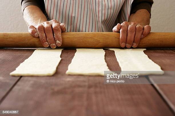Hands of woman making some whole wheat pasta