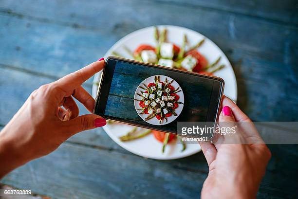 hands of woman taking picture of food ready to eat, close-up - photographing stock pictures, royalty-free photos & images