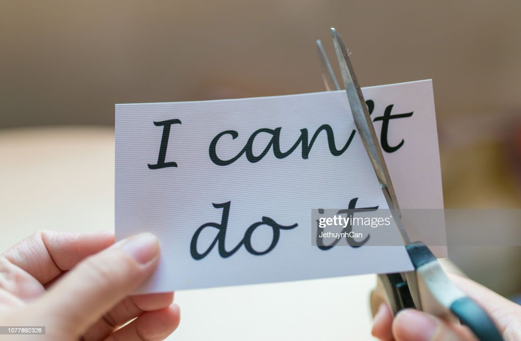 Hands of woman using scissors to remove the word I can't do it change to I can do it : Stock Photo