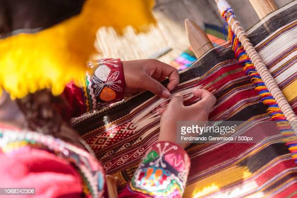 hands of woman weaving on loom - peru stock pictures, royalty-free photos & images