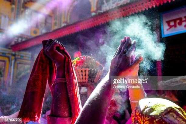 Hands of women who celebrate the Holi Festival are seen on March 21 2019 in Mathura India