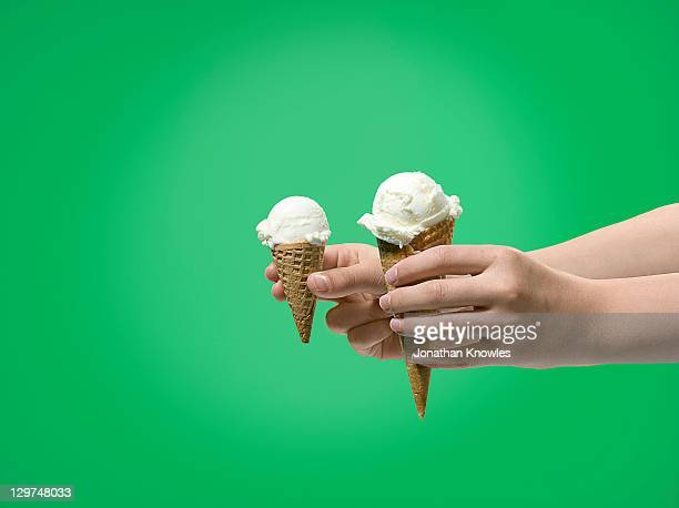 Hands offering ice cream, 2 sizes