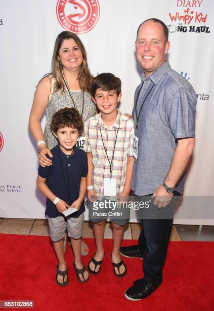"""Hands On Atlanta President and CEO Jay Cranman with family attend """"Diary Of A Wimpy Kid: The Long Haul"""" Atlanta screening hosted by Dwight Howard at..."""
