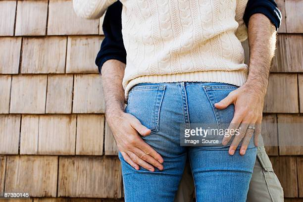 hands on buttocks - arse stock pictures, royalty-free photos & images