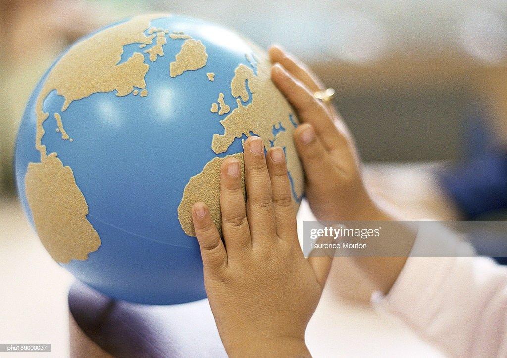 Hands on globe : Stockfoto