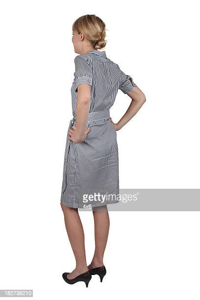 hands on hips rear view businesswoman - cut out dress stock pictures, royalty-free photos & images