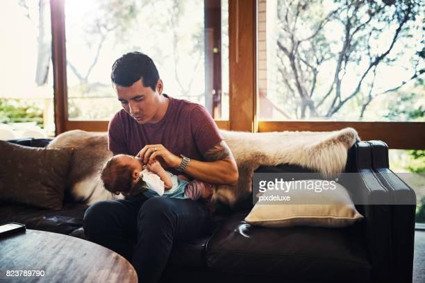 Hands on in raising his little boy