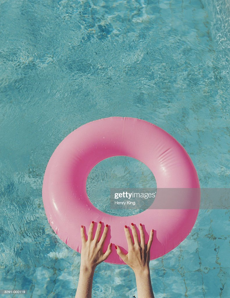 Hands on Inflatable Ring : Stock Photo