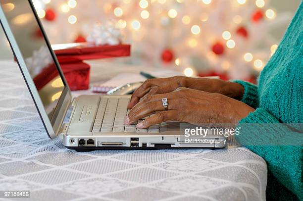 Hands on Laptop Keyboard for Christmas Internet Shopping