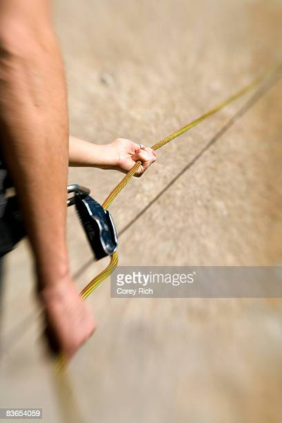 Hands on rope while belaying