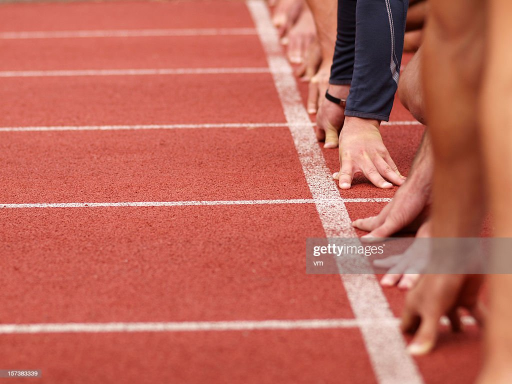 Hands on starting line : Stock Photo