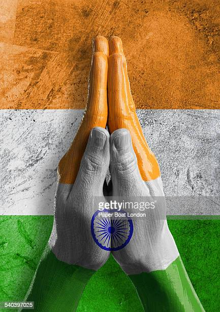 hands painted as flag of india in praying position - indian flag stock pictures, royalty-free photos & images