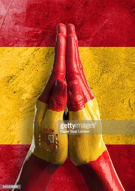 Hands painted as flag of Spain in praying position