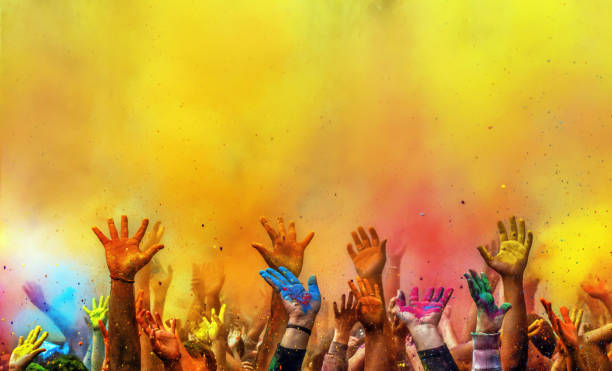 hands painted with different colors raised up on holi festival, washington dc, usa - 彩色影像 個照片及圖片檔