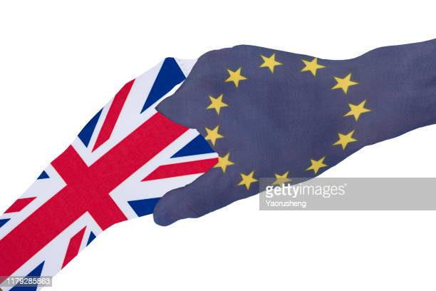 hands painted with uk and european flag reaching out for a brexit handshake - diplomacy stock pictures, royalty-free photos & images