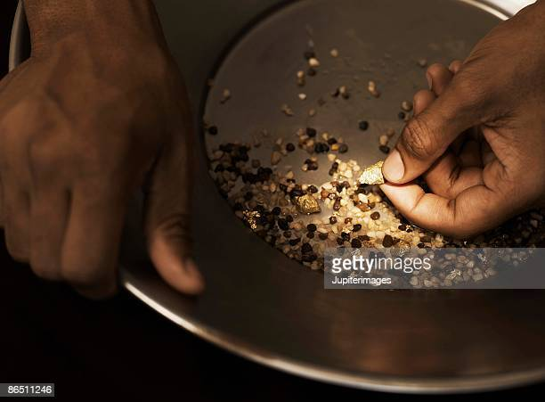 Hands panning for gold