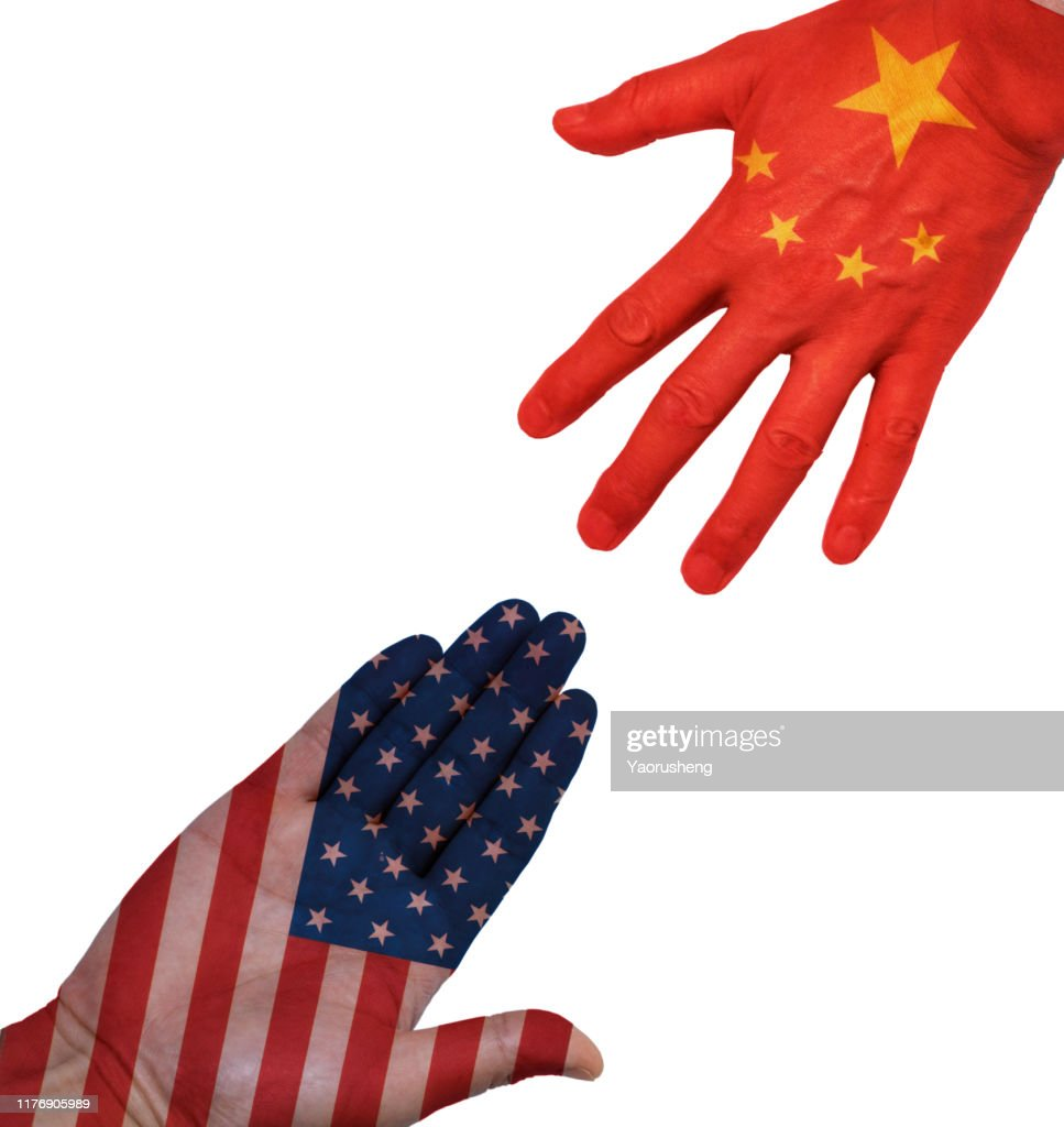 Hands people against the backdrop flags USA and China : Stock Photo