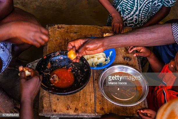 Hands picking food from plates
