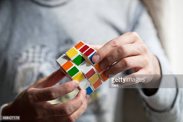 Hands playing a cube game