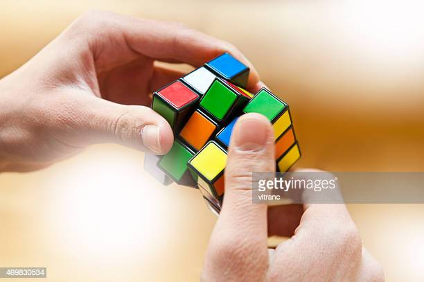 hands playing a cube game - solution stock pictures, royalty-free photos & images