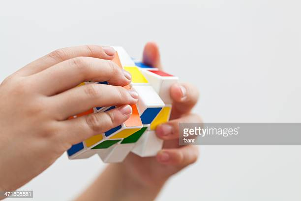 Hands playing a game cube