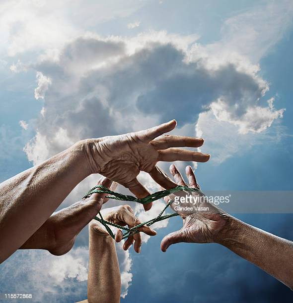 hands playing cat's cradle - intricacy stock pictures, royalty-free photos & images