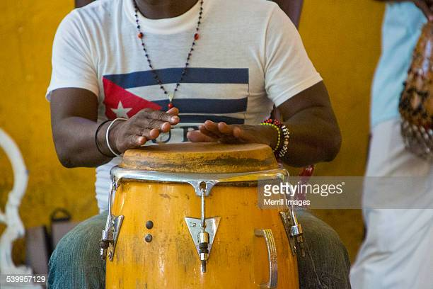 Hands playing Conga drum in Cuba