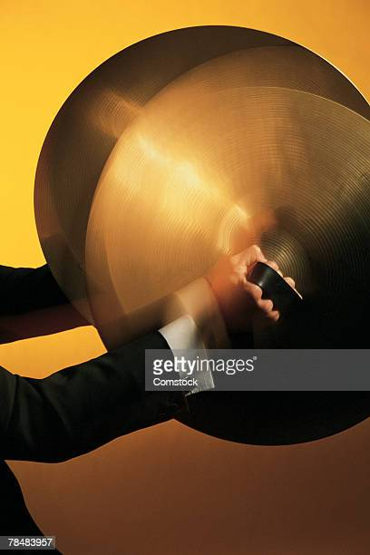 Hands playing cymbals