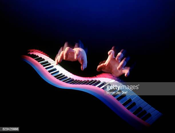 Hands playing flowing keyboard