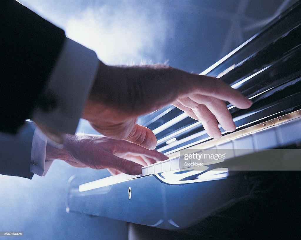 Hands playing piano keys : Stock Photo