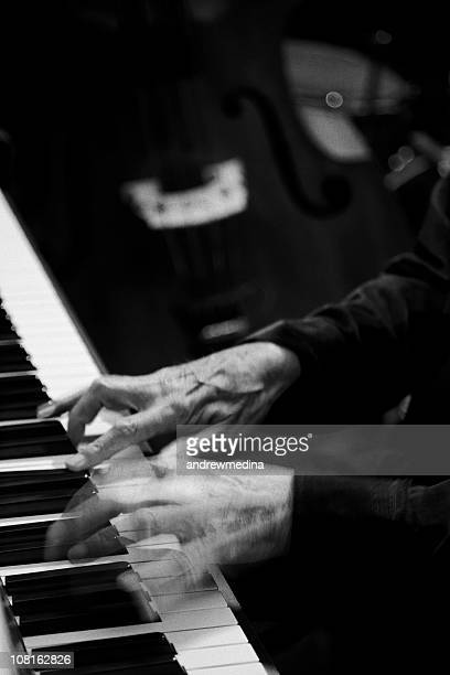 hands playing piano-black and white-more music/motion blur below - cabaret stock pictures, royalty-free photos & images