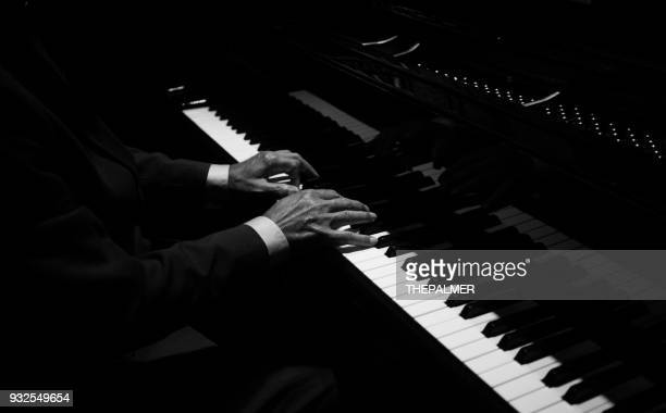 hands playing the piano - keyboard player stock photos and pictures