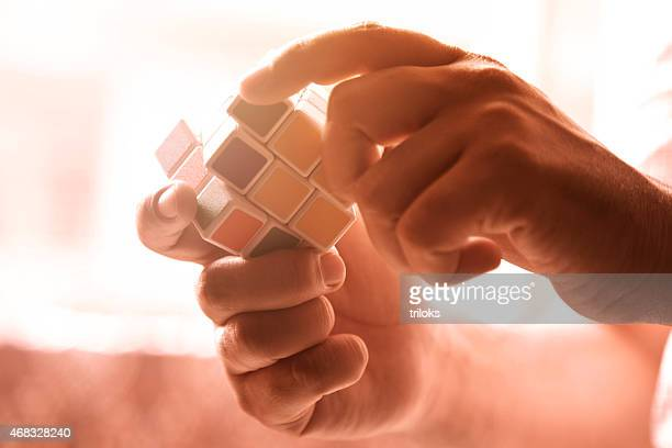 hands playing with colors cube - solutions stock pictures, royalty-free photos & images