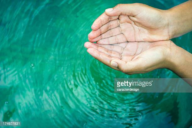 hands playing with fresh water - hands cupped stock pictures, royalty-free photos & images