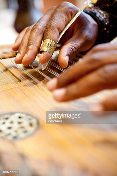 Hands playing Zither, Moroccan Guitar