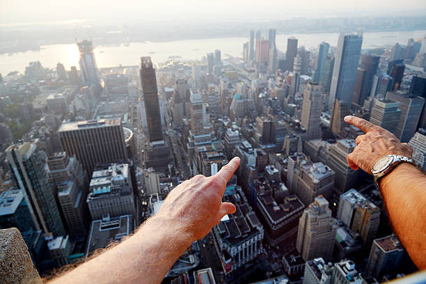 Hands Pointing At City As Seen From Above Wall Art