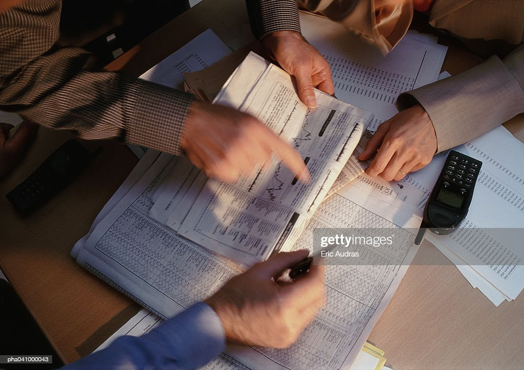 Hands pointing at documents : Stockfoto