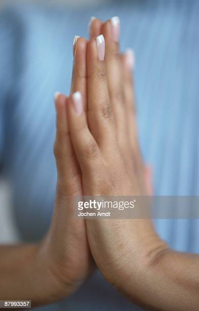 hands praying - wishful skin stock pictures, royalty-free photos & images