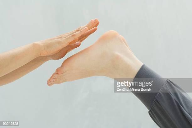 Hands prepared to massage feet, close-up
