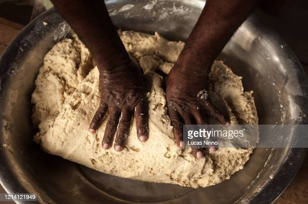 hands preparing dough. - baking bread stock pictures, royalty-free photos & images